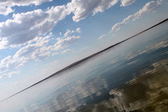 The sky reflected in the water, deserted beach lake, summer sky, nature, blue cloud,. Deserted beach lake, summer sky, nature blue cloud, Tuva, the sky reflected Royalty Free Stock Image