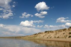 The sky reflected in the water, deserted beach lake, summer sky, nature, blue cloud,. Deserted beach lake, summer sky, nature blue cloud, Tuva, the sky reflected Royalty Free Stock Photos