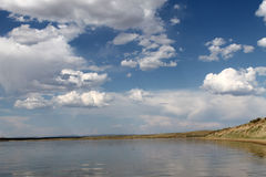 The sky reflected in the water, deserted beach lake, summer sky, nature, blue cloud,. Deserted beach lake, summer sky, nature blue cloud, Tuva, the sky reflected Stock Photos