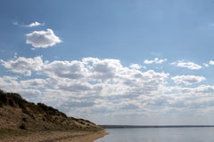 The sky reflected in the water, deserted beach lake, summer sky, nature, blue cloud,. Deserted beach lake, summer sky, nature blue cloud, Tuva, the sky reflected Royalty Free Stock Photography