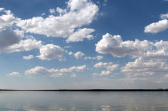 The sky reflected in the water, deserted beach lake, summer sky, nature, blue cloud,. Deserted beach lake, summer sky, nature blue cloud, Tuva, the sky reflected Stock Image