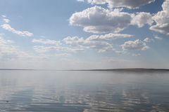 The sky reflected in the water, deserted beach lake, summer sky, nature, blue cloud,. Deserted beach lake, summer sky, nature blue cloud, Tuva, the sky reflected Stock Photo