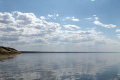 The sky reflected in the water, deserted beach lake, summer sky, nature, blue cloud, Stock Images