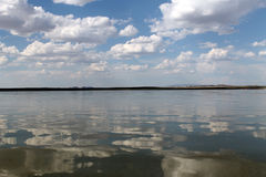 The sky reflected in the water, deserted beach lake, summer sky, nature, blue cloud, Stock Image
