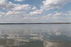 The sky reflected in the water, deserted beach lake, summer sky, nature, blue cloud, Stock Photography