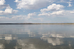 The sky reflected in the water, deserted beach lake, summer sky, nature, blue cloud, Royalty Free Stock Photography