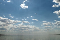 The sky reflected in the water, deserted beach lake, summer sky, nature, blue cloud, Royalty Free Stock Image