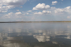 The sky reflected in the water, deserted beach lake, summer sky, nature, blue cloud, Stock Photo