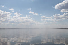 The sky reflected in the water, deserted beach lake, summer sky, nature, blue cloud, Stock Photos