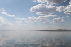 The sky reflected in the water, deserted beach lake, summer sky, nature, blue cloud, Royalty Free Stock Photo