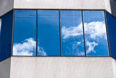 The sky reflected on a window. At the facade of a building Royalty Free Stock Image