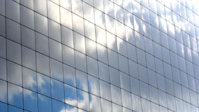The sky reflected in the Windows of a skyscraper.  Royalty Free Stock Photo