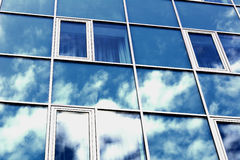 The sky reflected in the Windows of a skyscraper.  Stock Image
