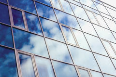 The sky reflected in the Windows of a skyscraper.  Royalty Free Stock Images