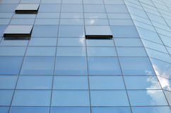 Sky reflecting in Corporation Building Windows. The sky reflects in the windows of a corporation building Royalty Free Stock Photos