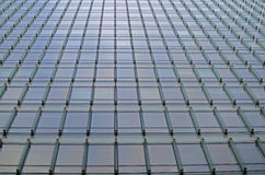 Sky reflecting in Corporation Building Windows Royalty Free Stock Photography