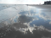 Sky reflecting in Ocean Waves on Coney Island. Royalty Free Stock Images