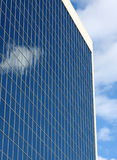 Sky reflecting off of a building. stock images