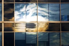 Sky reflecting in office windows Royalty Free Stock Image