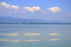 Sky reflecting in smooth lake water Royalty Free Stock Photography