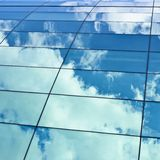 Sky reflection in the building's windows Royalty Free Stock Image