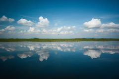 Sky reflection. Reflection of Cumulus Clouds over the Lake stock photography