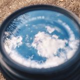 Sky reflection in glass. Sky reflections in lens glass Stock Photo