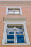 Sky reflection in the glass of window freshly renovated house Royalty Free Stock Images