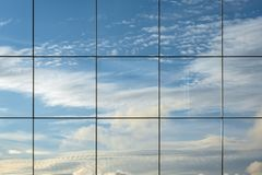 Free Sky Reflection In Modern Skyscraper Window. Cloudscape View Reflected In Futuristic Architectural Structure. Abstract View, Space Royalty Free Stock Images - 167490249