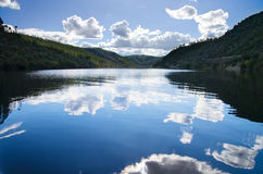 Sky reflection in river Royalty Free Stock Image