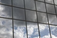 Sky reflection in a window stock images