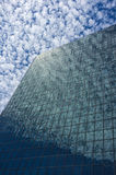 Transparent Building. Sky reflection on windows of a glass building making it appear transparent Stock Photo