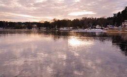 Sky reflections in frozen lake on sunset Stock Images