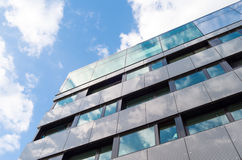 Sky reflections in glass walls. Office building located in Warsaw Centre Stock Photos