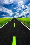Sky road. Asphalt road that is surrounded by rice fields. And sky Royalty Free Stock Image