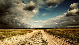 The sky and road in a field Stock Photos