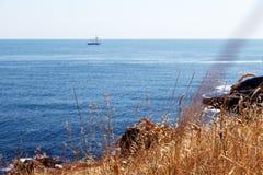 Sky rock sea shore Stock Photos