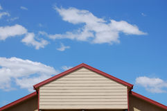 Sky and Roof. Contrast between rood roof and blue sky Royalty Free Stock Images