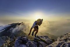Free Sky Runner Man Uphill On Rocks At Sunset Royalty Free Stock Photo - 195556865