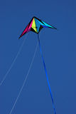 The sky´s the limit. Colorful kite flying in air on a clear day stock image