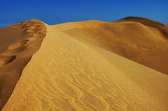 Sky and sand. Sand dunes Stock Photography