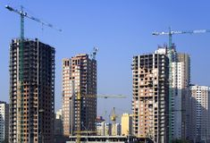 Sky-scrapers building cranes Royalty Free Stock Photography