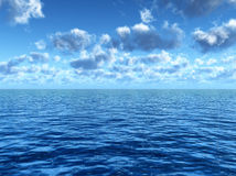 Sky and sea. Cloudy blue sky leaving for horizon above a blue surface of the sea Stock Photography