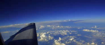 SKY, SEA AND CLOUDS. View from aeroplane flying over cloudy ocean at high altitude royalty free stock photography