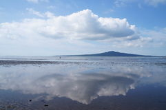 Sky on Sea reflection at Devonport island, New Zealand. Reflection of the sky on sea surface of Devonport beach Stock Photography