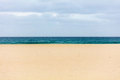 Sky, sea, sand. Cloudy sky, deep blue sea and sand as three layers Royalty Free Stock Image