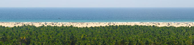 Sky, sea, sand and jungle tranquil panorama for relaxation. (Kerala, India Stock Photography