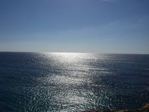 Sky, sea and solar reflections Royalty Free Stock Photography