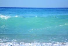 Sky, sea, waves and sandy beach. stock photo