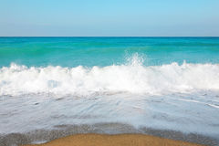 Sky, sea, waves and sandy beach. Stock Images